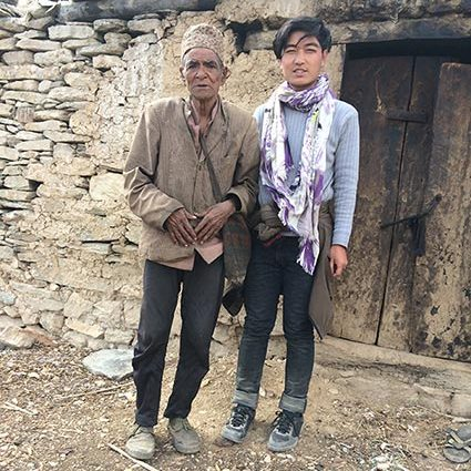 Sagar with the father of one of our Outreach Program children who he can now support.
